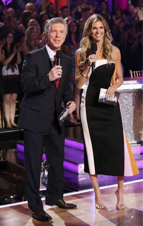 "<div class=""meta ""><span class=""caption-text "">Co-hosts Tom Bergeron and Erin Andrews appear during week 4 of ABC's 'Dancing With The Stars' season 18 on April 7, 2014.The episode featured the anticipated 'Switch-Up' -- for the first time, celebrities danced with different dance pro partners. There was no elimination. Next week, the celebrities will be reunited with their regular partners and will receive a score based on both weeks' performances. One pair is expected to be eliminated. (ABC Photo / Adam Taylor)</span></div>"