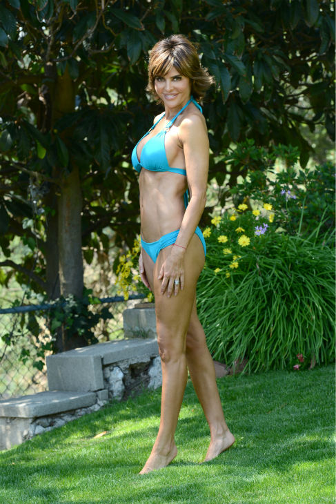 Lisa Rinna poses in a bikini at a pool party in Beverly Hills, California on July 5, 2013. She turned 50 on the 11th. <span class=meta>(Michael Simon &#47; startraksphoto.com)</span>