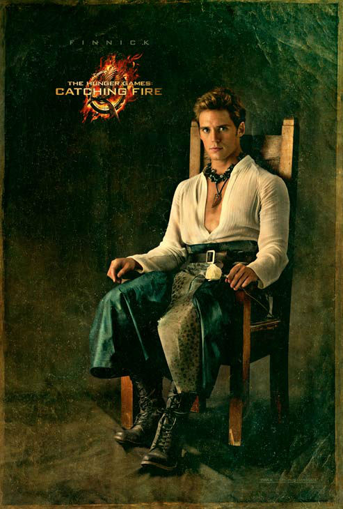 Sam Claflin poses as Finnick Odair in 'The...