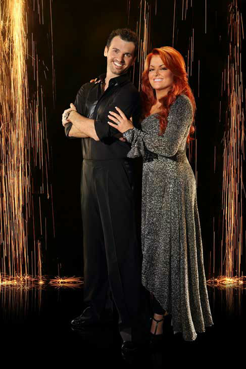 Wynonna Judd and partner Tony Dovolani appear in...
