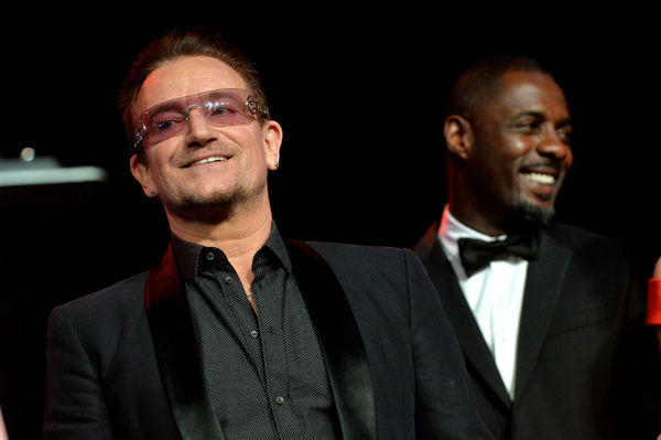 Honoree Bono accepts the Sonny Bono Visionary award from actor Idris Elba onstage during the 25th annual Palm Springs International Film Festival awards gala at Palm Springs Convention Center on January 4, 2014 in Palm Springs, California.  <span class=meta>(Michael Buckner&#47;Getty Images for PSIFF)</span>