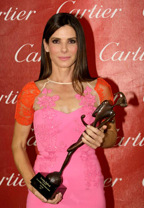 Actress Sandra Bullock poses with the Desert Palm Achievement Award - Actress for &#39;Gravity&#39; backstage during the 25th annual Palm Springs International Film Festival awards gala at Palm Springs Convention Center on January 4, 2014 in Palm Springs, California. <span class=meta>(Jeff Vespa&#47;Getty Images for PSIFF)</span>
