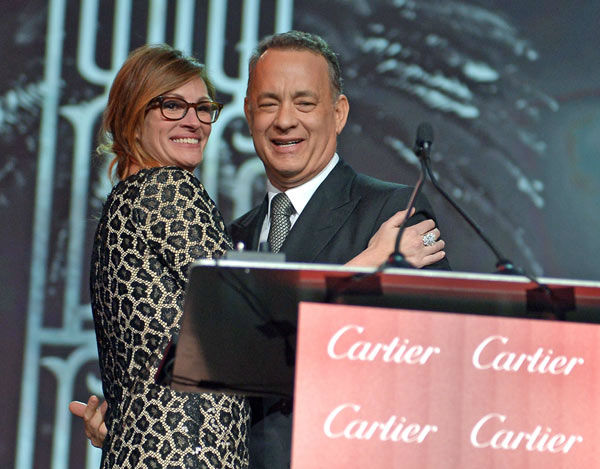 Actress Julia Roberts presents the Chairman&#39;s Award to actor Tom Hanks onstage during the 25th annual Palm Springs International Film Festival awards gala at Palm Springs Convention Center on January 4, 2014 in Palm Springs, California. <span class=meta>(Charley Gallay&#47;Getty Images for PSIFF)</span>