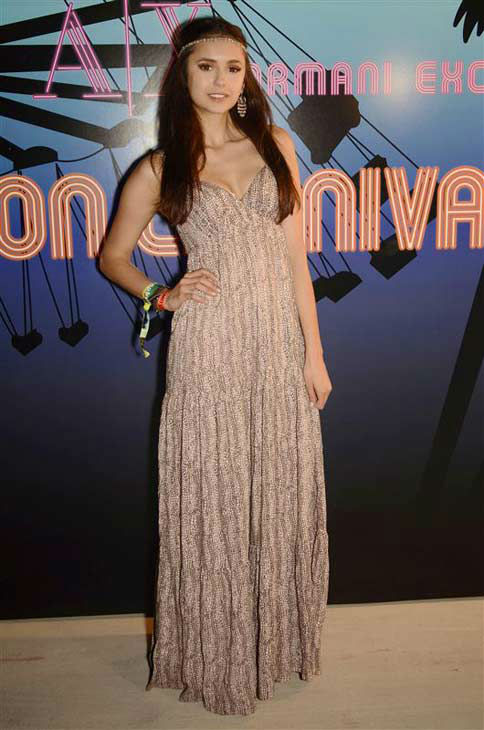 Nina Dobrev appears at the Armani Exchange and 944 Magazine Neon Carnival on April 16, 2011.