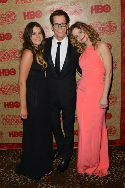 Kevin Bacon and wife Kyra Sedwick appear with their daughter Sosie Bacon, Miss Golden Globe 2014, at a 2014 Golden Globe Awards after party in Beverly Hills, California on Jan. 12, 2014.