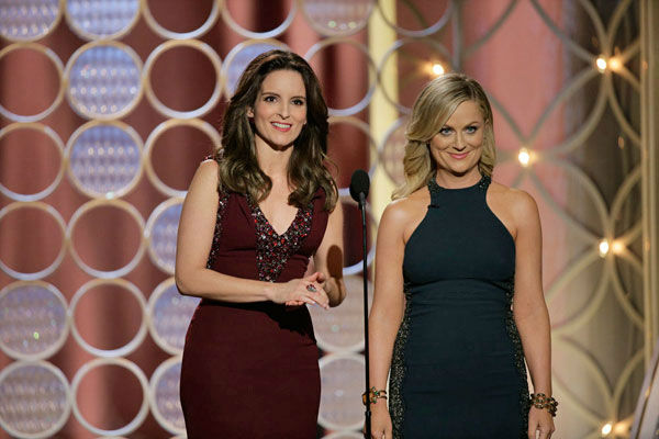 Tina Fey and Amy Poehler appear at the Golden Globe Awards on Jan. 12, 2014.