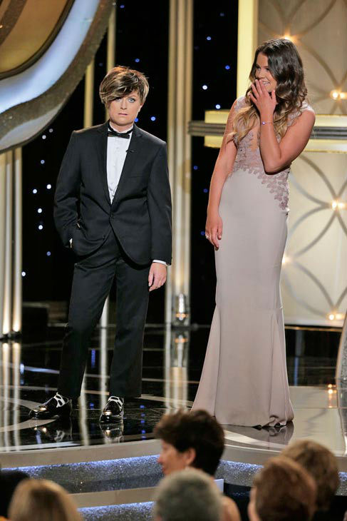 Amy Poehler plays Tina Fey&#39;s pretend teenage son Randy  After Kevin Bacon and Kyra Sedgwick introduced their daughter, Sosie Bacon, as Miss Golden Globe 2014, Tina Fey stepped up to make things a little equal between the genders and introduced her son Randy, who was played by Amy Poehler in a Justin Bieber-inspired wig, as Mr. Golden Globe for the year.   &#39;Hey your name is Sosie,&#39; Randy says to Miss Golden Globe 2014. &#39;What are you? The Olympics?&#39;   &#39;God, I hate being here,&#39; Randy later said. &#39;Jacqueline Bisset is backstage bothering me.&#39;   &#40;Pictured: Amy Poehler and Sosie Bacon appear at the Golden Globe Awards on Jan. 12, 2014.&#41; <span class=meta>(Paul Drinkwater&#47;NBC)</span>