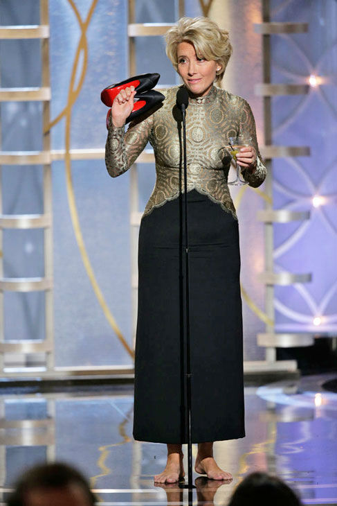 Emma Thompson shoes off lets loose  When Emma Thompson showed up to the stage to present Best Screenplay, she appeared with her Louboutins heels in one hand and a martini in the other.   When it came time to announce the winner &#40;Spike Jonze&#41; Thompson realized she didn&#39;t have a free hand to open the envelope and tossed her shoes behind her and handed off her drink to someone off screen.  &#40;Pictured: Emma Thompson appears at the Golden Globe Awards on Jan. 12, 2014.&#41; <span class=meta>(Paul Drinkwater&#47;NBC)</span>