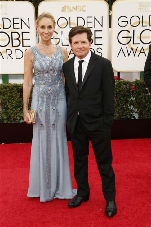 Michael J. Fox and wife Tracy Pollan appear at the 2014 Golden Globe Awards in Beverly Hills, California on Jan. 12, 2014. The two married in July 1988 and are parents to four children - a son, and three daughters, including twins. <span class=meta>(Lehmann &#47; Startraksphoto.com)</span>