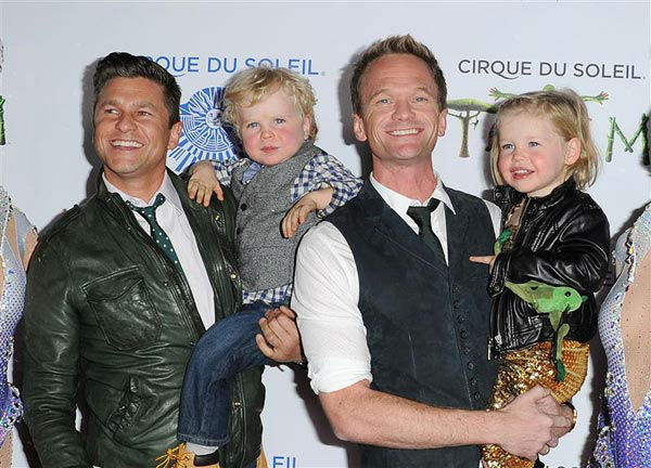 Neil Patrick Harris and David Burtka appear with their children, Gideon Scott Burtka-Harris and Harper Grace Burtka-Harris, at the opening night of TOTEM from Cirque du Soleil in Santa Monica, California on Jan. 21, 2014.