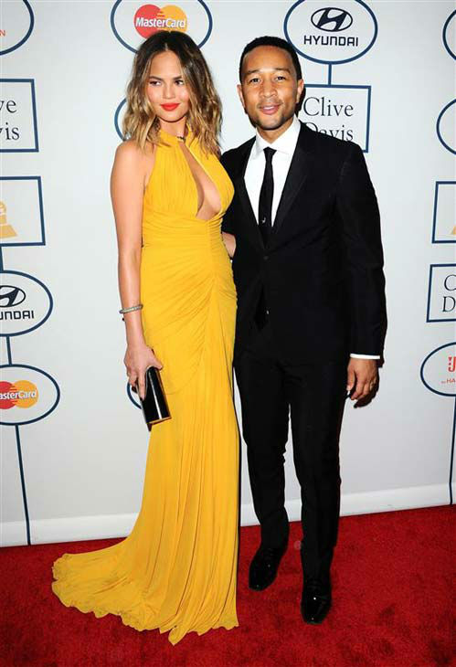 Chrissy Teigen and John Legend appear at the 2014 Clive Davis Pre-Grammy party in Los Angeles, California on Jan. 25, 2014.