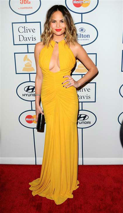 Chrissy Teigen appears at the 2014 Clive Davis Pre-Grammy party in Los Angeles, California on Jan. 25, 2014.