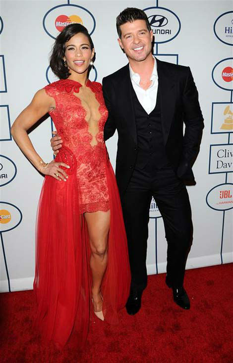 Paula Patton and Robin Thicke appear at the 2014 Clive Davis Pre-Grammy party in Los Angeles, California on Jan. 25, 2014.