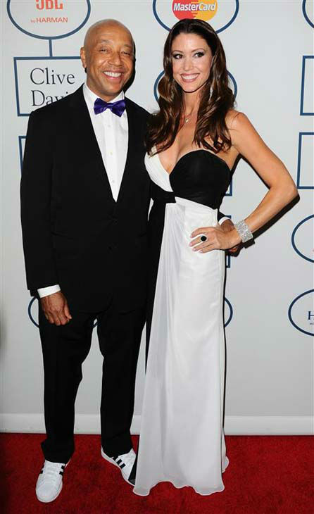 Russell Simmons and Shannon Elizabeth appear at the 2014 Clive Davis Pre-Grammy party in Los Angeles, California on Jan. 25, 2014. <span class=meta>(Sara De Boer &#47; startraksphoto.com)</span>