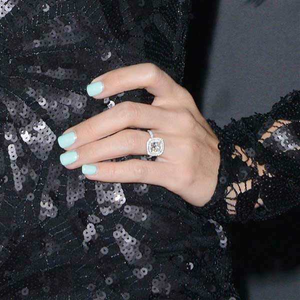 Ashley Tisdale shows off her engagement ring at the premiere of the R-rated comedy movie 'That Akward Moment' at L.A. Live Regal Cinemas in Los Angeles on Jan. 27, 2014.