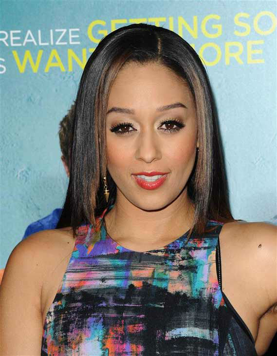 Tia Mowry appears at the premiere of the R-rated comedy movie 'That Akward Moment' at L.A. Live Regal Cinemas in Los Angeles on Jan. 27, 2014.
