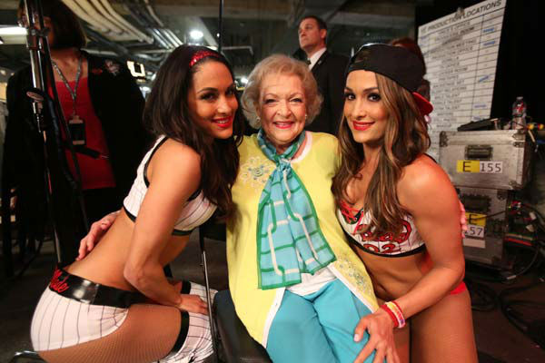 "<div class=""meta image-caption""><div class=""origin-logo origin-image ""><span></span></div><span class=""caption-text"">Betty White appears on WWE's 'Monday Night Raw' with the Bella Twins on Feb. 10, 2014. (WWE)</span></div>"