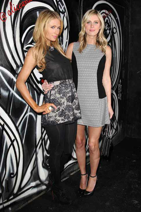 Paris and Nicky Hilton appear at the Alice &#43; Olivia presentation during Fall 2014 Mercedes-Benz Fashion Week in New York City on Feb. 10, 2014.  <span class=meta>(Kristina Bumphrey &#47; startraksphoto.com)</span>