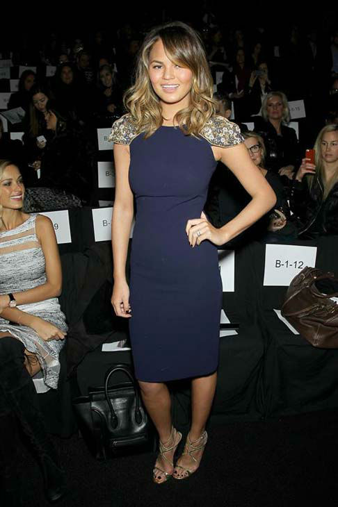 Chrissy Teigen appears at the Badgley Mischka show during Fall 2014 Mercedes-Benz Fashion Week in New York City on Feb. 11, 2014.  <span class=meta>(Marion Curtis &#47; startraksphoto.com)</span>