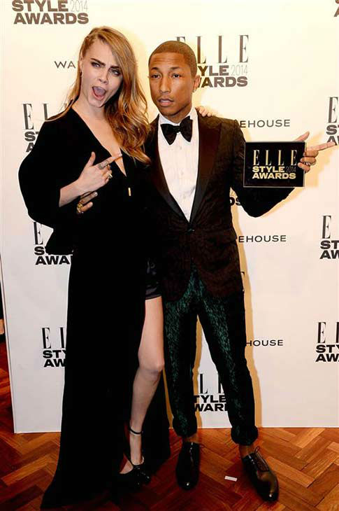Model Cara Delevingne and Pharrell Williams appear at the 2014 Elle Style Awards in London, England on Feb. 18, 2014.  <span class=meta>(Richard Young &#47; startraksphoto.com)</span>