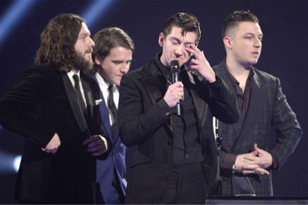 "<div class=""meta image-caption""><div class=""origin-logo origin-image ""><span></span></div><span class=""caption-text"">The band Arctic Monkeys appears on stage at the 2014 BRIT Awards in London on Feb. 19, 2013. The group won British Group and British Album Of The Year for 'AM.' (Richard Young / REX / Startraksphoto.com)</span></div>"