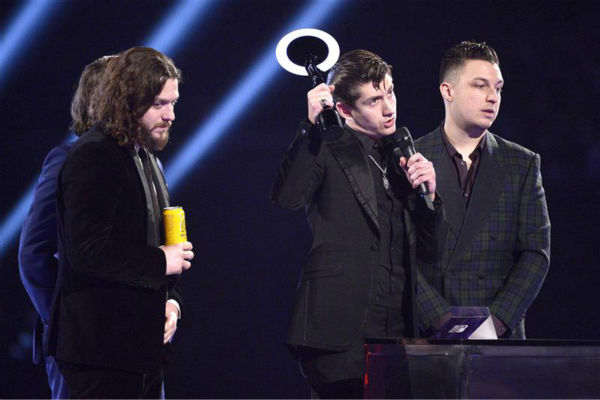 The band Arctic Monkeys appears on stage at the 2014 BRIT Awards in London on Feb. 19, 2013. The group won British Group and British Album Of The Year for &#39;AM.&#39; <span class=meta>(Richard Young &#47; REX &#47; Startraksphoto.com)</span>