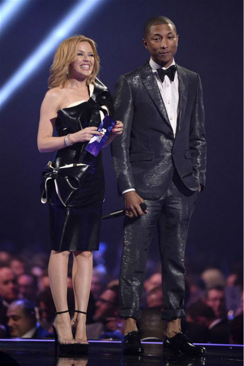Kylie Minogue and Pharrell Williams appear on stage at the 2014 BRIT Awards in London on Feb. 19, 2014. <span class=meta>(Richard Young &#47; REX &#47; Startraksphoto.com)</span>