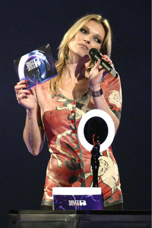 Kate Moss accepts David Bowie&#39;s award for British Male Artist of the Year at the 2014 BRIT Awards in London on Feb. 19, 2014. Bowie, 67, did not attend the ceremony. Moss&#39; co-presenter, Noel Gallagher, joked that the supermodel was sent as New York-based Bowie&#39;s &#39;representative on Earth.&#39; <span class=meta>(Richard Young &#47; REX &#47; Startraksphoto.com)</span>