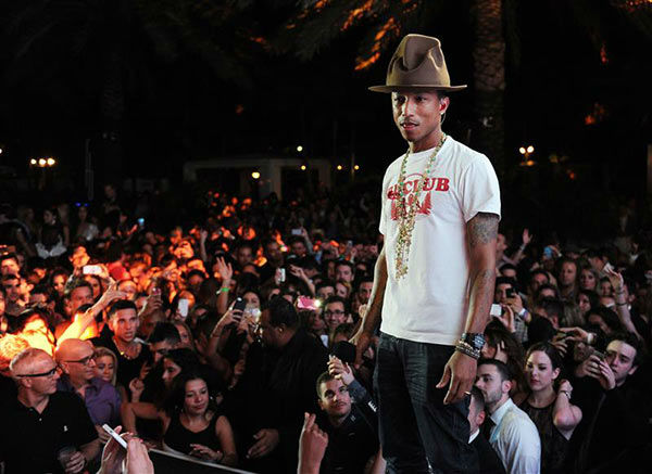 "<div class=""meta ""><span class=""caption-text "">Pharrell Williams appears at a New Years Eve event in Miami on Dec. 31, 2013. (Seth Browarnik/startraksphoto.com)</span></div>"