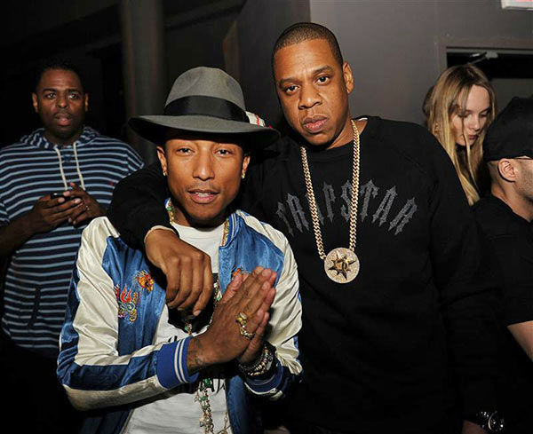 "<div class=""meta ""><span class=""caption-text "">Pharrell Williams and Jay Z appear at the' Magna Carter' Tour After Party in Miami on Jan. 1, 2014. (Seth Browarnik/startraksphoto.com)</span></div>"