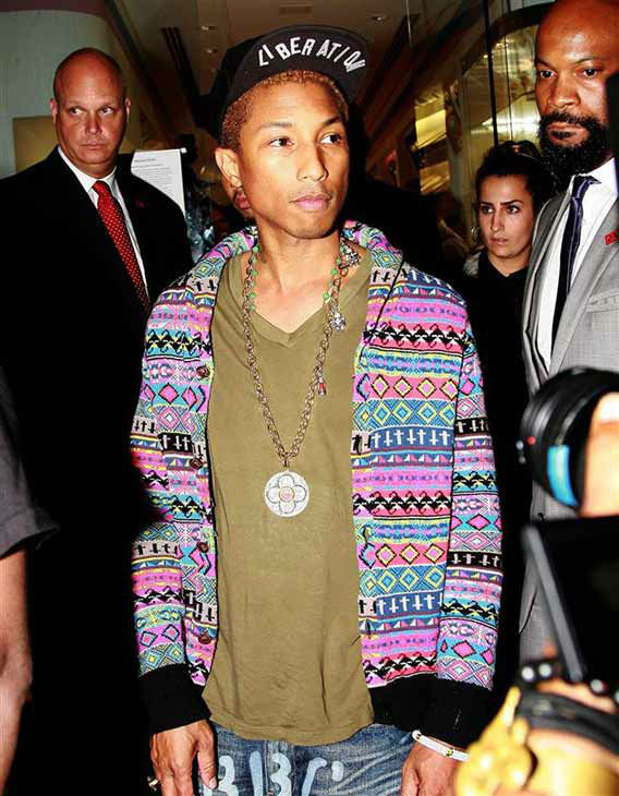"<div class=""meta ""><span class=""caption-text "">Pharrell Williams appears during NYC Fashion Night Out on Sept. 6, 2012. (Cam Griffith/startraksphoto.com)</span></div>"
