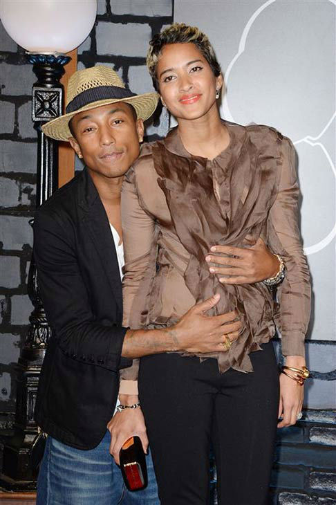 Pharrell Williams and model&#47;designer Helen Lasichanh arrive at the 2013 MTV Video Music Awards on Aug. 25, 2013. Williams and Lasichanh wed in October 2013. <span class=meta>(Lionel Hahn&#47;AbacaUSA&#47;startraksphoto.com)</span>