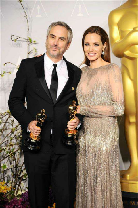 Alfonso Cuaron and Angelina Jolie appear in the press room at the 2014 Oscars on March 2, 2014. <span class=meta>(Kyle Rover&#47;startraksphoto.com)</span>