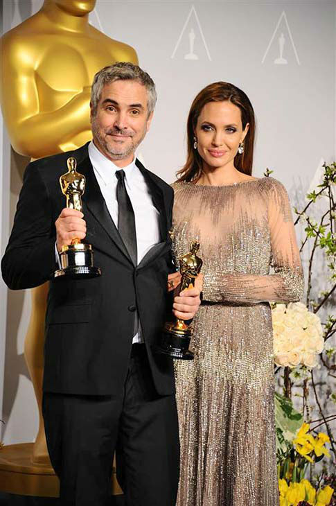 "<div class=""meta image-caption""><div class=""origin-logo origin-image ""><span></span></div><span class=""caption-text"">Alfonso Cuaron and Angelina Jolie appear in the press room at the 2014 Oscars on March 2, 2014. (Kyle Rover/startraksphoto.com)</span></div>"