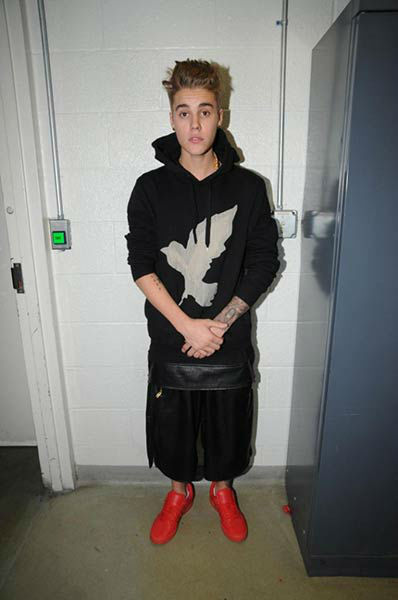 "<div class=""meta ""><span class=""caption-text "">Justin Bieber appears at the Miami Beach Police Department following his January 2014 arrest. He was asked to show his identifying marks on his body while being processed in jail. (Miami Beach Police Department)</span></div>"