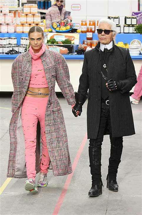 Model Cara Delevingne and designer Karl Lagerfeld appear at the Chanel show during Fall&#47;Winter 2014 Paris Fashion week on March 4, 2014.  <span class=meta>(Hendrik Ballhausen &#47; startraksphoto.com)</span>