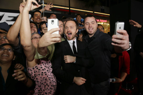 "<div class=""meta image-caption""><div class=""origin-logo origin-image ""><span></span></div><span class=""caption-text"">Aaron Paul takes selfies with fans at the premiere of DreamWorks Pictures' 'Need For Speed' at The TCL Chinese Theatre in Hollywood, California on March 6, 2014. (Eric Charbonneau / Invision for DreamWorks Pictures / AP Images)</span></div>"