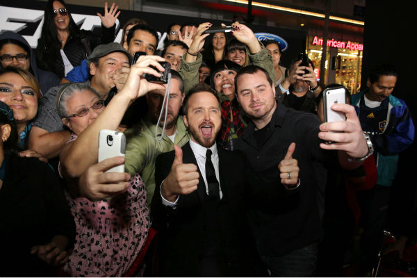 Aaron Paul takes selfies with fans at the premiere of DreamWorks Pictures&#39; &#39;Need For Speed&#39; at The TCL Chinese Theatre in Hollywood, California on March 6, 2014. <span class=meta>(Eric Charbonneau &#47; Invision for DreamWorks Pictures &#47; AP Images)</span>