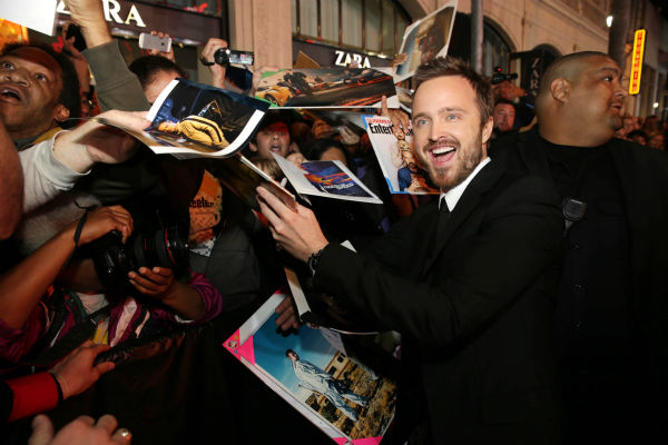 Aaron Paul signs photos for fans at the premiere of DreamWorks Pictures&#39; &#39;Need For Speed&#39; at The TCL Chinese Theatre in Hollywood, California on March 6, 2014. <span class=meta>(Eric Charbonneau &#47; Invision for DreamWorks Pictures &#47; AP Images)</span>