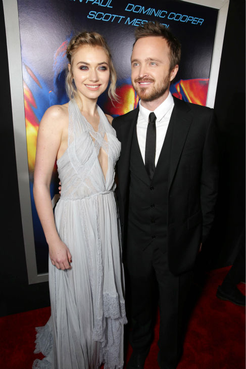 Aaron Paul and co-star Imogen Poots attend the premiere of DreamWorks Pictures&#39; &#39;Need For Speed&#39; at The TCL Chinese Theatre in Hollywood, California on March 6, 2014. <span class=meta>(Eric Charbonneau &#47; Invision for DreamWorks Pictures &#47; AP Images)</span>