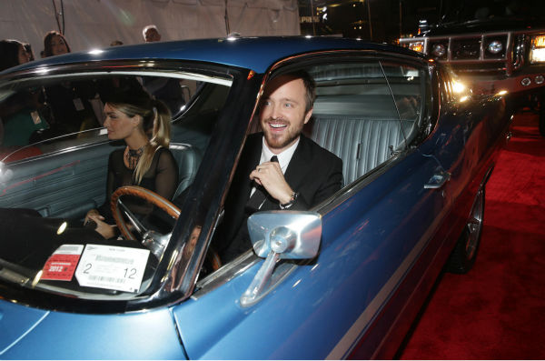 "<div class=""meta image-caption""><div class=""origin-logo origin-image ""><span></span></div><span class=""caption-text"">Aaron Paul and wife Lauren Parsekian arrive in a car on the red carpet at the premiere of DreamWorks Pictures' 'Need For Speed' at The TCL Chinese Theatre in Hollywood, California on March 6, 2014. (Eric Charbonneau / Invision for DreamWorks Pictures / AP Images)</span></div>"