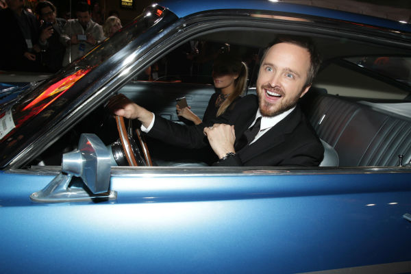 Aaron Paul and wife Lauren Parsekian arrive in a car on the red carpet at the premiere of DreamWorks Pictures&#39; &#39;Need For Speed&#39; at The TCL Chinese Theatre in Hollywood, California on March 6, 2014. <span class=meta>(Eric Charbonneau &#47; Invision for DreamWorks Pictures &#47; AP Images)</span>