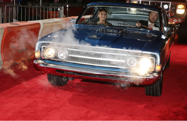 "<div class=""meta ""><span class=""caption-text "">Aaron Paul and wife Lauren Parsekian arrive in a car on the red carpet at the premiere of DreamWorks Pictures' 'Need For Speed' at The TCL Chinese Theatre in Hollywood, California on March 6, 2014. (Eric Charbonneau / Invision for DreamWorks Pictures / AP Images)</span></div>"