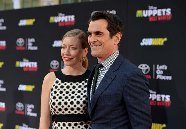 Ty Burrell &#40;R&#41; and Holly Burrell arrive at the world premiere of Disney&#39;s &#39;Muppets Most Wanted&#39; at the El Capitan Theatre on March 11, 2014 in Hollywood, California. <span class=meta>(Alberto E. Rodriguez&#47;Getty Images for Disney)</span>