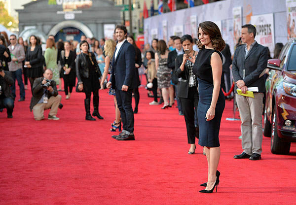"<div class=""meta ""><span class=""caption-text "">Tina Fey arrives at the world premiere of Disney's 'Muppets Most Wanted' at the El Capitan Theatre on March 11, 2014 in Hollywood, California.  (Alberto E. Rodriguez/Getty Images for Disney)</span></div>"