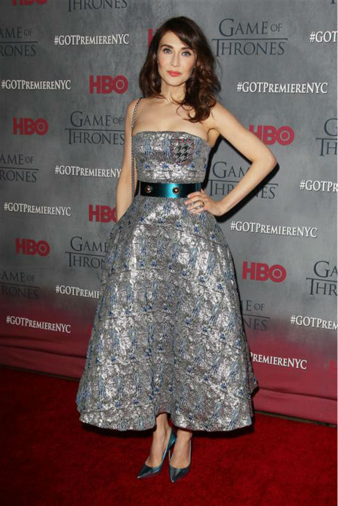 "<div class=""meta ""><span class=""caption-text "">'Game of Thrones' star Carice Van Houten (Melisandre) appears at the season 4 premiere of the hit HBO series in New York on March 18, 2014. The show returns on April 6. She is wearing a strapless, metallic Dior Spring 2014 dress. (Kristina Bumphrey / Startraksphoto.com)</span></div>"