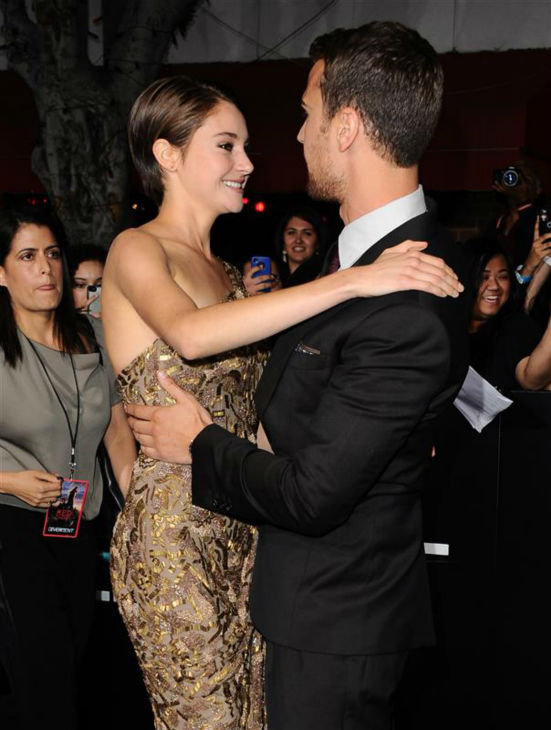 Shailene Woodley &#40;Tris&#41; and Theo James &#40;Four&#41; appear at the premiere of &#39;Divergent&#39; in Los Angeles on March 18, 2014. <span class=meta>(Sara De Boer &#47; Startraksphoto.com)</span>