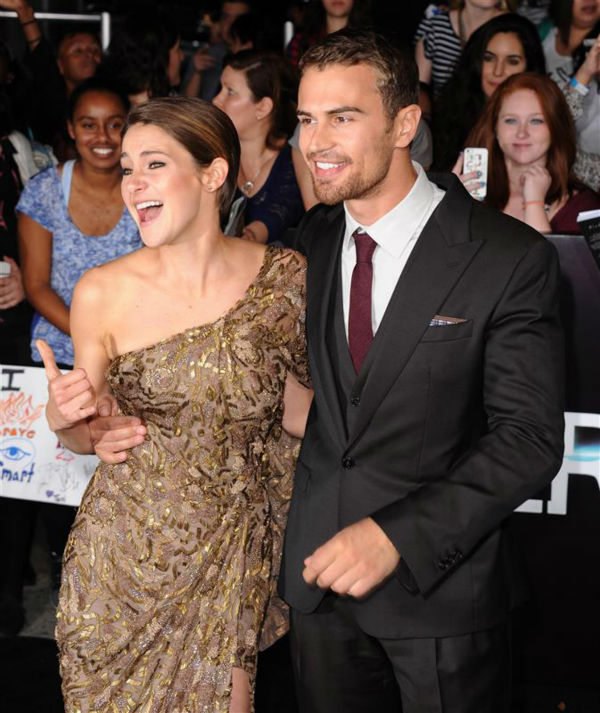 Shailene Woodley &#40;Tris&#41; and Theo James &#40;Four&#41; appear at the premiere of &#39;Divergent&#39; in Los Angeles on March 18, 2014. <span class=meta>(Hollywood Press &#47; AbacaUSA &#47; Startraksphoto.com)</span>