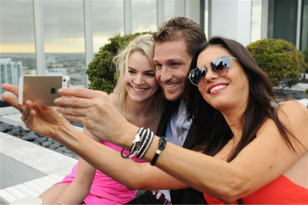 "<div class=""meta image-caption""><div class=""origin-logo origin-image ""><span></span></div><span class=""caption-text"">Juan Pablo Galavis, star of ABC's 'The Bachelor' season 18, and winner Nikki Ferrell pose for a selfie with Adriana De Moura, star of the Bravo reality show 'The Real Housewives of Miami' at the Moet and Chandon 'Tiny Tennis' with Roger Federer event at Club 50 at Viceroy Miami on March 19. (Seth Browarnik / Startraksphoto.com)</span></div>"