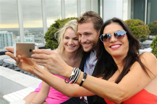 "<div class=""meta ""><span class=""caption-text "">Juan Pablo Galavis, star of ABC's 'The Bachelor' season 18, and winner Nikki Ferrell pose for a selfie with Adriana De Moura, star of the Bravo reality show 'The Real Housewives of Miami' at the Moet and Chandon 'Tiny Tennis' with Roger Federer event at Club 50 at Viceroy Miami on March 19. (Seth Browarnik / Startraksphoto.com)</span></div>"